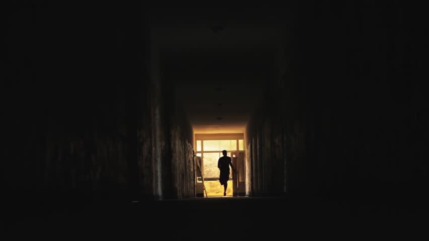 Man Running in Dark Tunnel Danger Concept HD #4540955