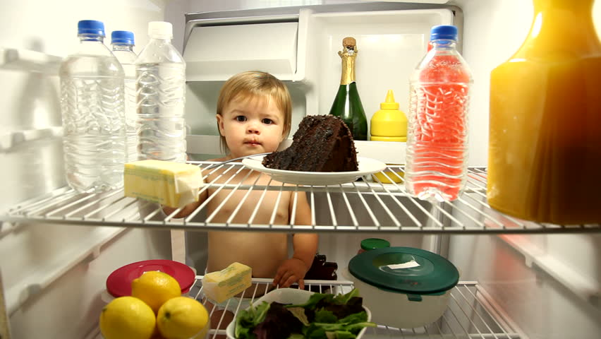 Baby eating chocolate cake in refrigerator | Shutterstock HD Video #4549403