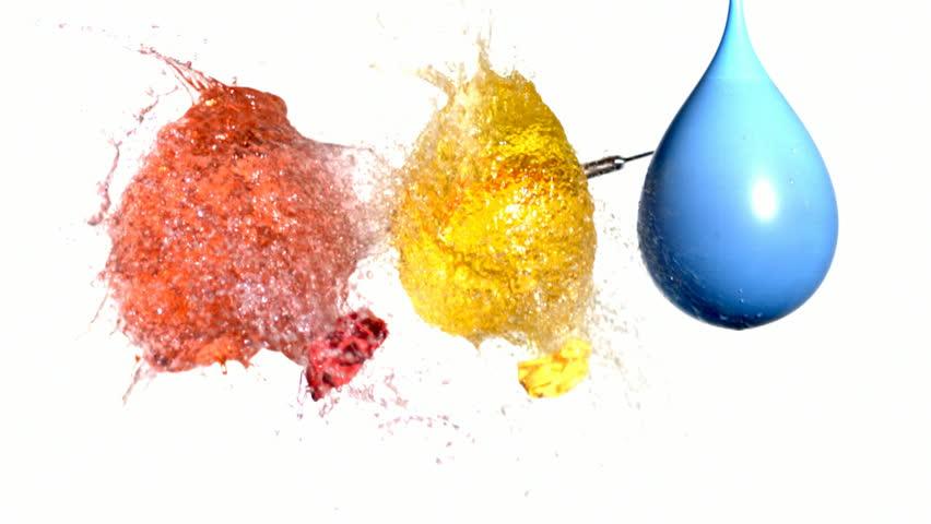 Dart pops three water balloons, slow motion