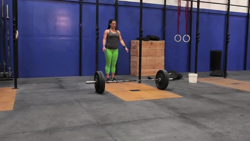 Strong girl snatches heavy weight and misses the lift