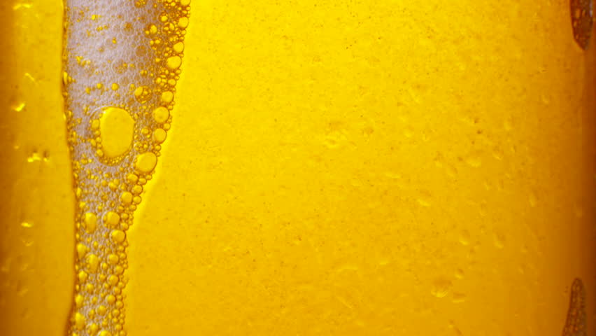 Glass of beer with bubbles