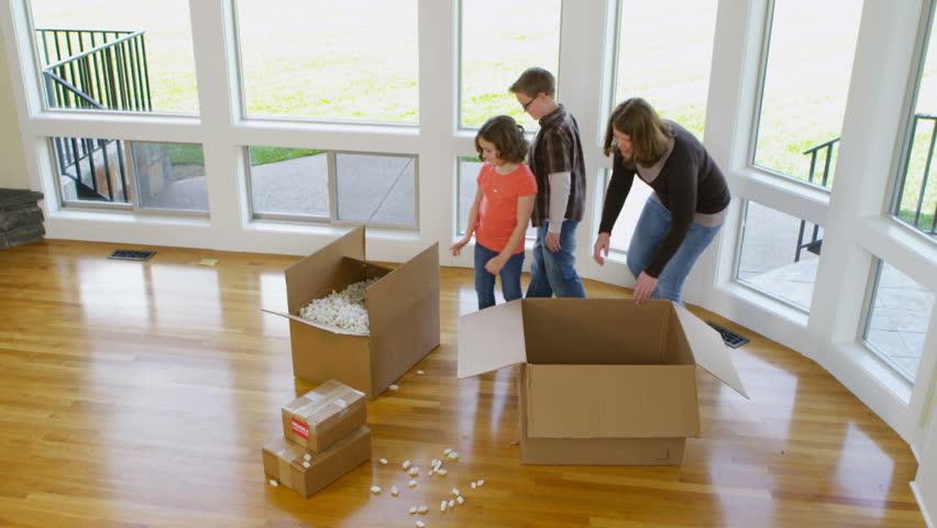 Family having fun in new home