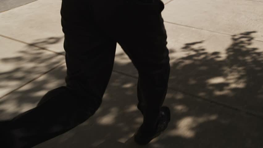 Businessman running through city