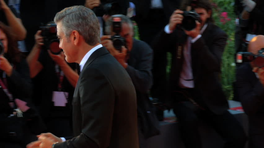 """VENICE - AUGUST 28: The actor George Clooney on the red carpet for the movie """"Gravity"""" during the 70th International Venice Film Festival on August 28, 2013 in Venice."""