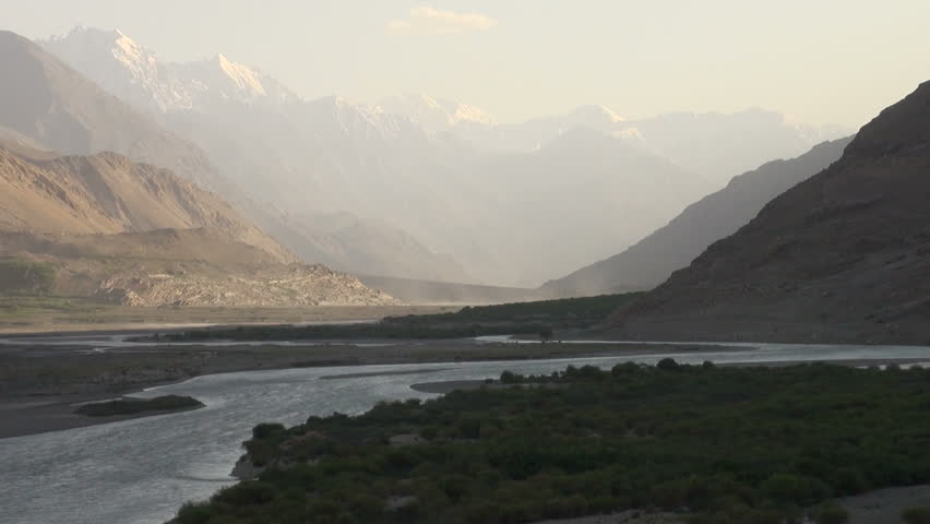 A river finds its way through the spectacular Wakhan valley, seperating Tajikistan from Afghanistan