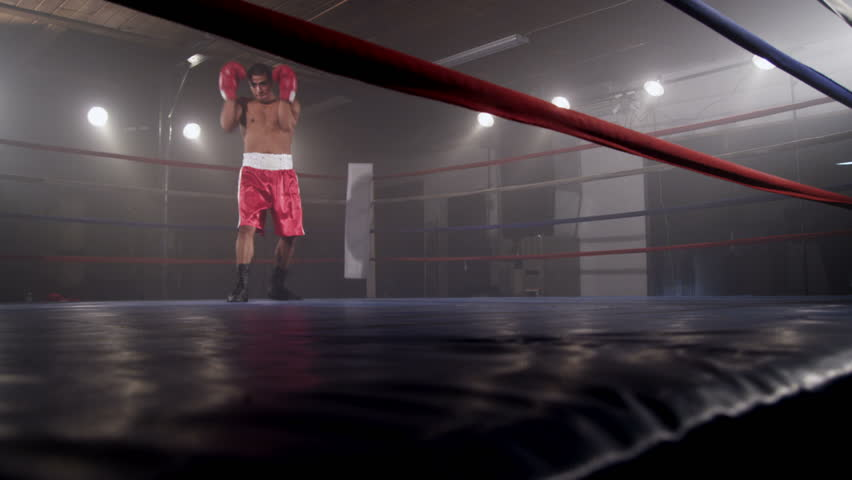 Boxer training in boxing ring