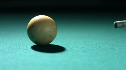 Closeup shot of cue ball being hit, slow motion