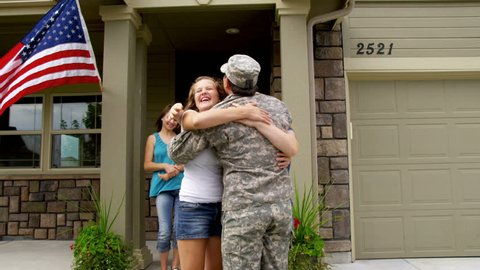 Family runs out to greet soldier