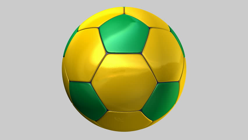 A regular stitched panel soccer ball in the iconic brazilian colors of green blue and yellow rotating on an isolated white studio background
