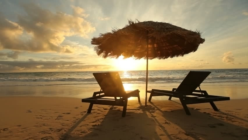 Sunrise at tropical beach with chairs and hut