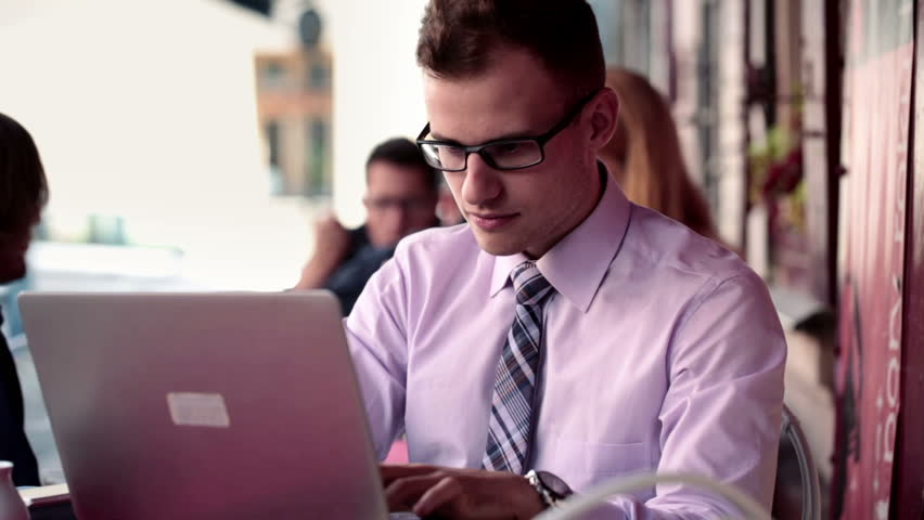 Successful happy businessman with laptop computer in cafe  | Shutterstock HD Video #4612829