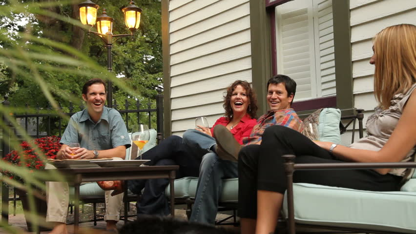 Group Of People Sitting On Patio Together Talking And Laughing Stock  Footage Video 4618550   Shutterstock
