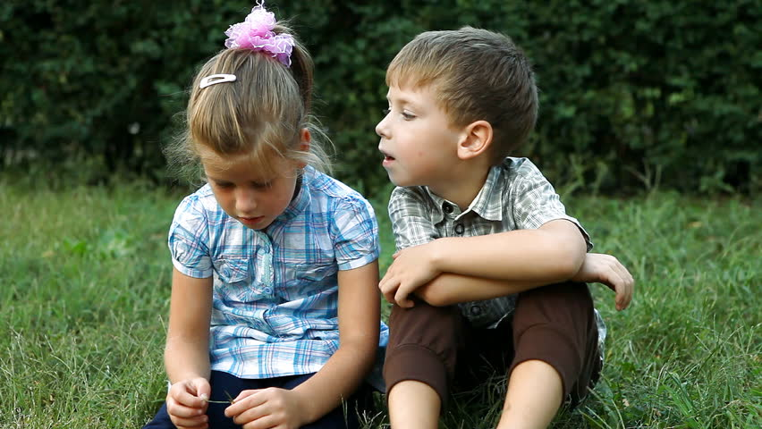 Two Kids On A Lawn, Having Fun, Smiling And Kissing Stock -1057
