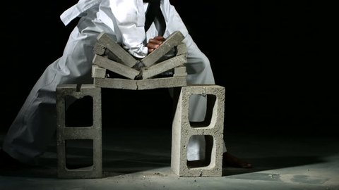 Karate chop breaks stack of bricks, slow motion