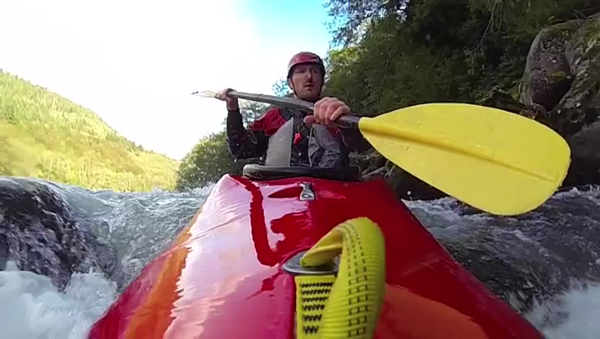 Whitewater kayaking, flip and roll, slow motion