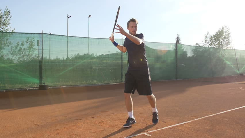 Slow Motion Shot Of A Professional Tennis Player Hitting The Ball With Tennis