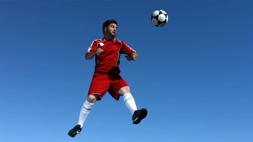 Soccer player jumps in the sky, slow motion | Shutterstock HD Video #4654442