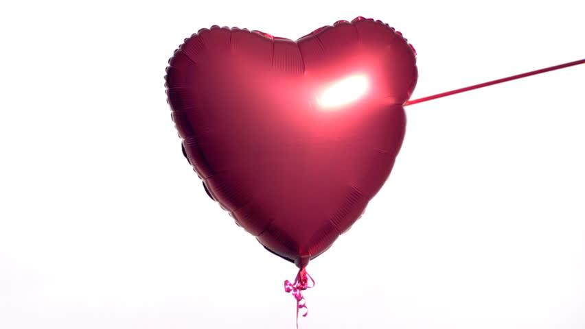 Valentine's Day balloon shot by arrow