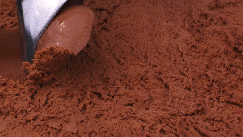 Close up of chocolate ice cream being scooped  | Shutterstock HD Video #4658300