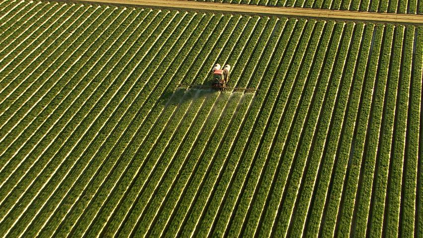 Aerial shot of tractor spraying field | Shutterstock HD Video #4658534