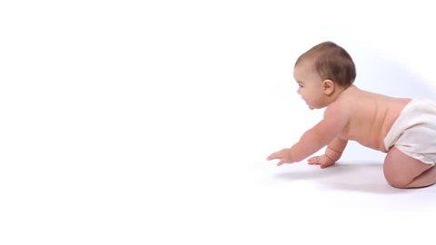 Baby crawling against white background