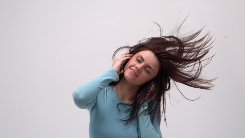 hd00:14Happy young woman dancing while listening to music on ...