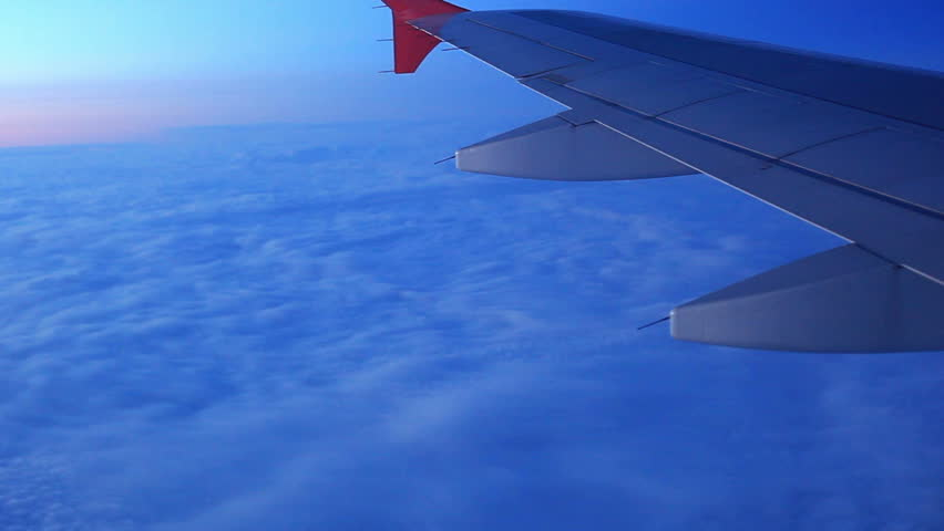 Airplane wing above clouds.