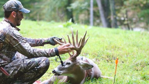 Successful archery hunter with his Whitetail Deer trophy buck.