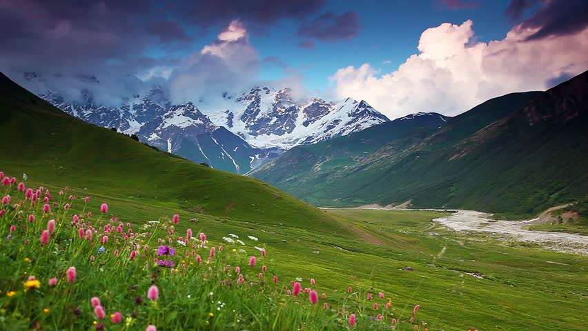 Majestic sunset at the foot of  Mt. Shkhara. Dramatic sky. Upper Svaneti, Georgia, Europe. Caucasus mountains. Beauty world. HD video clip (High Definition)