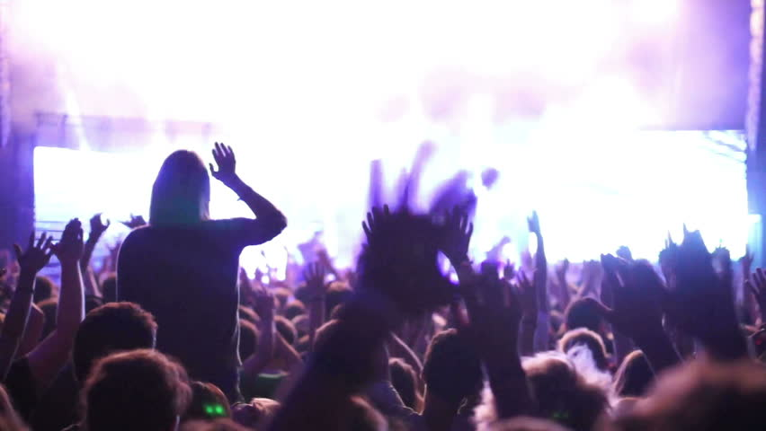 Shot of some cheering fans at a life concert, normal speed, some visible noise due high ISO, soft focus, also slow motion version of this video aviable in my portfolio | Shutterstock HD Video #4749140