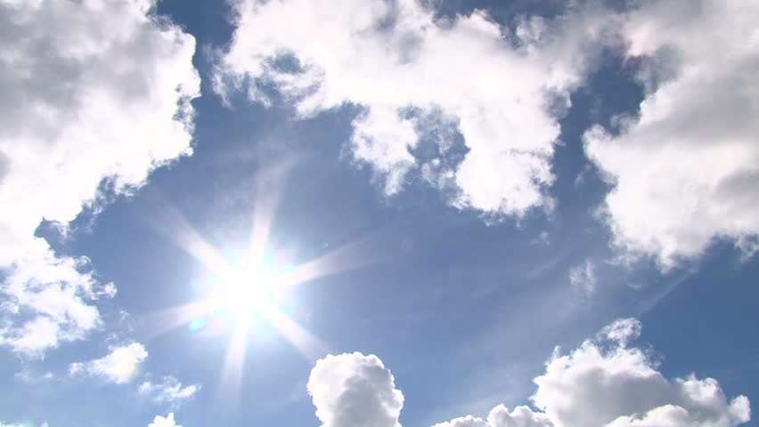 One hour time lapse of cloudscape with bright sun shining behind dark storm