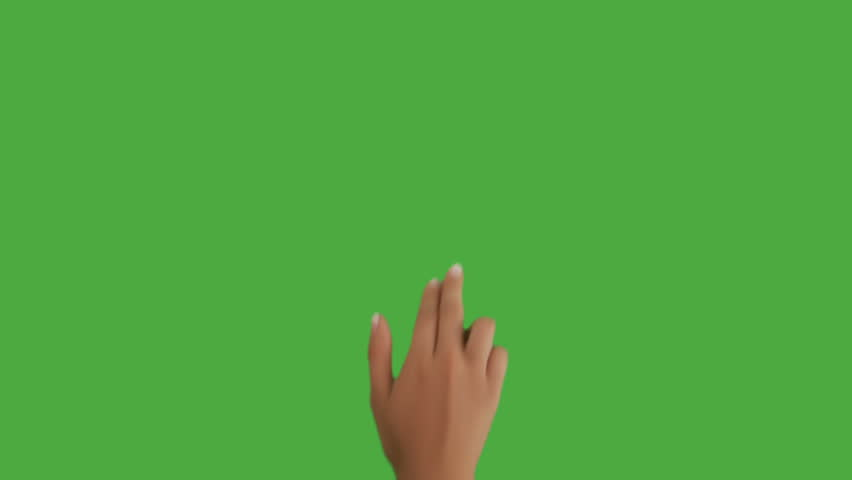Isolated shot of a female hand on a green screen doing touch screen gestures, flicking to the right