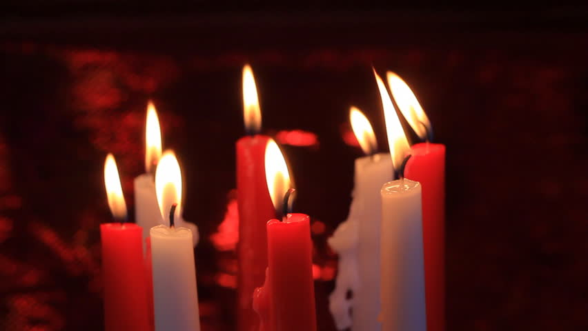 Looping Three Red Candles Burn Brightly And Flicker