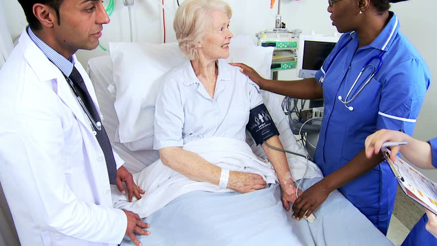 Close up of nursing staff monitoring blood pressure of an elderly female patient in a hospital ward | Shutterstock HD Video #4761440