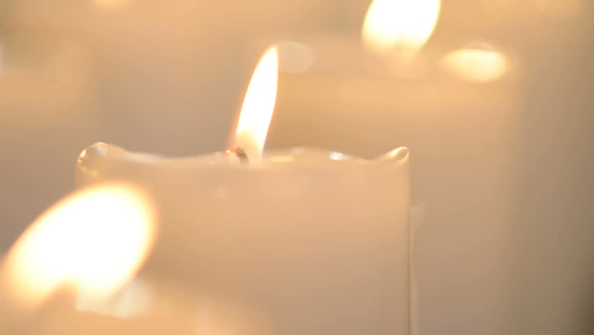 Edited Shot Of A White Candle And Multiple White Candles Burning With Soft