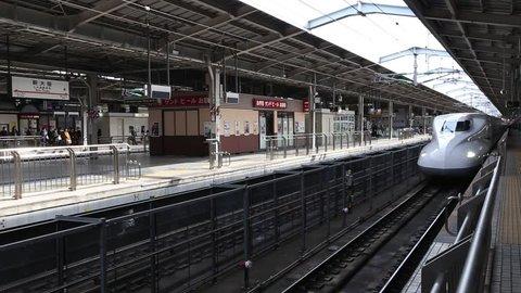 OSAKA, JAPAN - APRIL 1, 2013: A Japanese Bullet Train (Shinkansen) arrives Shin-Osaka Station on Apr 1, 2013 in Osaka, Japan. Shinkansen maximum operating speed is 320 km/h (200 mph).