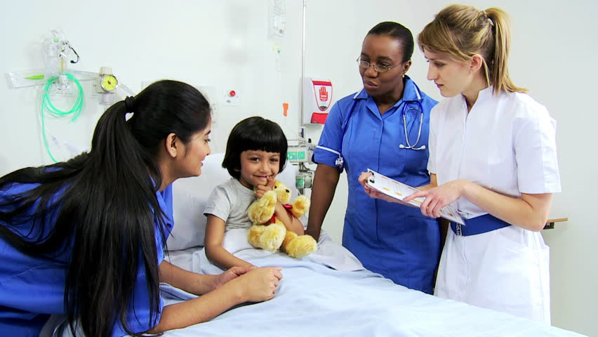 Multi-ethnic female nursing staff recording recovery progress of a young pediatric patient after a procedure in the hospital | Shutterstock HD Video #4781510