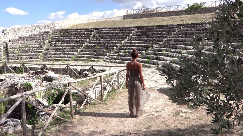 beautiful young girl in an ancient greek theater