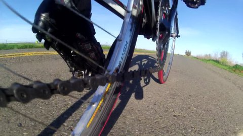 Bicycle Road Cyclist cool low angle POV point of view  of chain sprocket peddling on country road HD high definition stock video footage 1080 1920x1080
