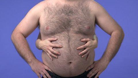 Woman's hands hugging a confident overweight man. High definition video shot on studio blue screen.