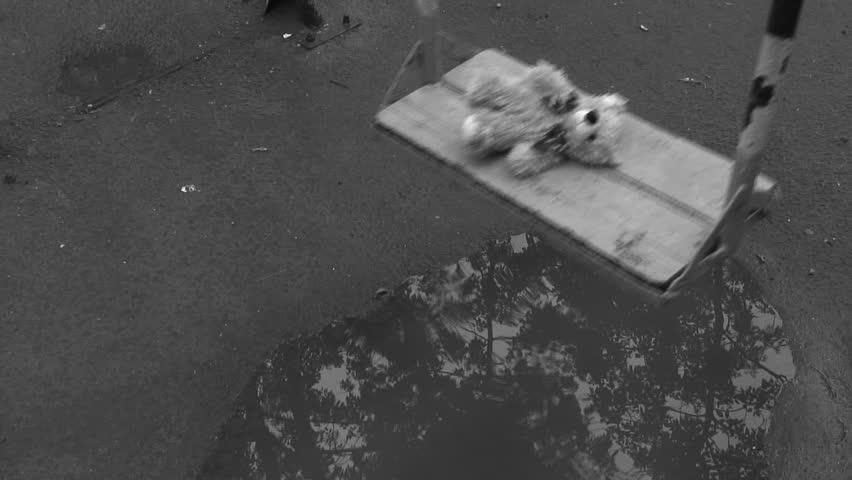 Forgotten Teddy bear on a swing under rain. Deep depression theme. Black and white. | Shutterstock HD Video #481042