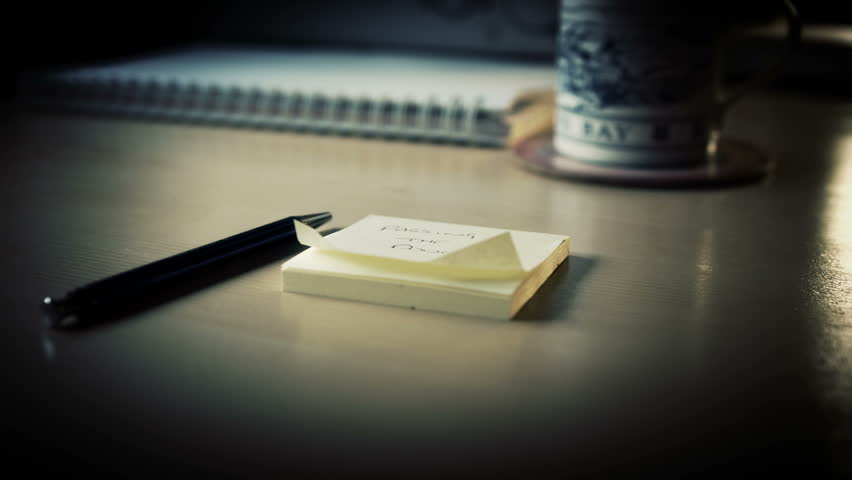 Note Pad and Pen. A sliding shot of a desktop with a Pen and Notepad in the foreground filmed on the Blackmagic Cinema Camera
