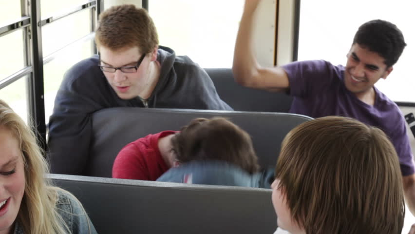 Kid being harassed and picked on by bullies on a school bus