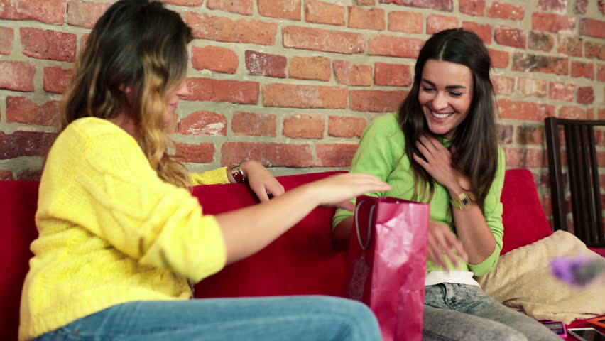 Woman Giving Birthday Gift To Her Best Friend In Home