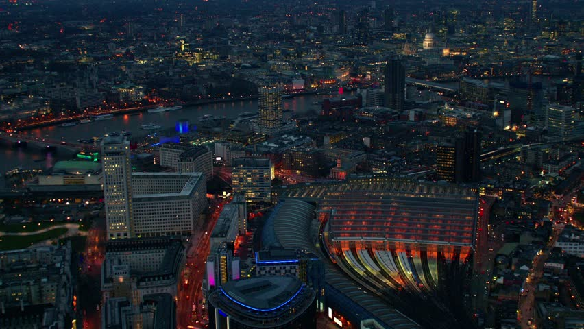 Early evening aerial shot of Central London. Sequence features Waterloo train station, St Paul's Cathedral and the River Thames.