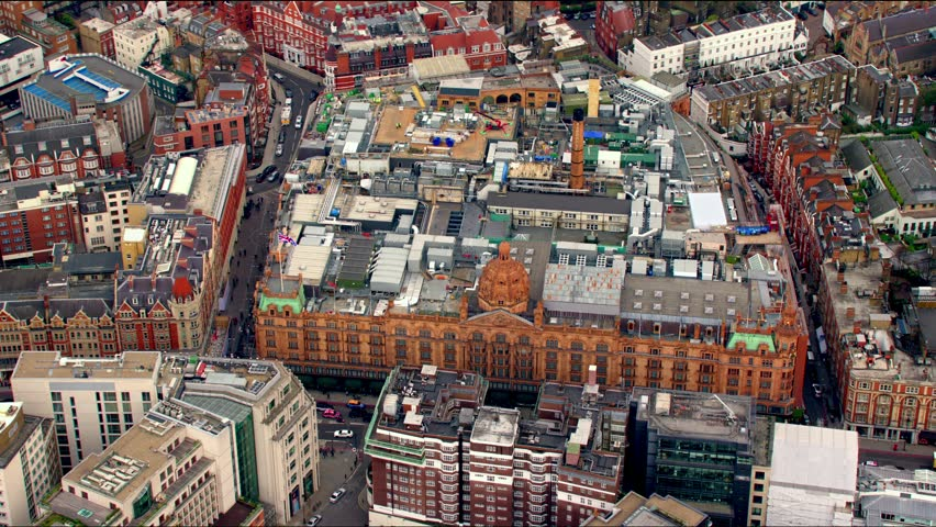 Aerial sequence of the Knightsbridge district in Central London, UK. Features the famous luxury department store, Harrods.