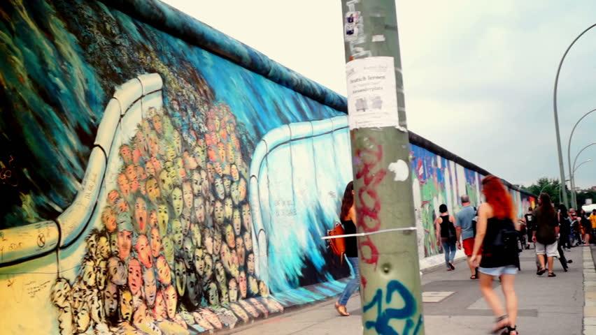 Berlin, Germany-circa 2013:East Side Gallery - people walking near remnants of the Berlin Wall in Friedrichshain in Berlin