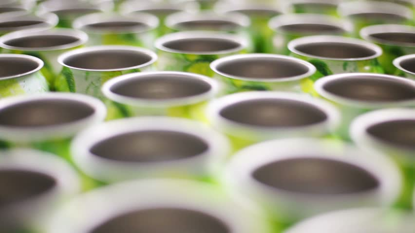 Many empty aluminum cans for drinks move on conveyor, close-up | Shutterstock HD Video #4854389