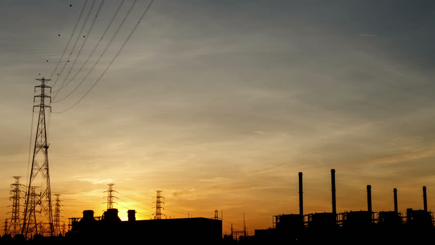 Electric power station at sunrise, time lapse