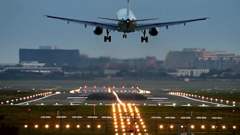 Airliner is Landing at Hamburg Airport (HAM), one edit - front back view